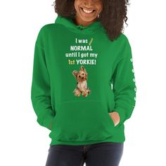 A new hoodie for women Yorkshire Terrier mom and parent from our new collection, Almost normal, with white paw prints on the left sleeve.