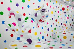This psychedelic garden is part of A Dream I Dreamed, a touring exhibition of work by iconic Japanese artist Yayoi Kusama. A white room with a breakout of rainbow polka dots, the installation features two stainless steel sculptures of giant potted flowers. Despite their enormity, the blooms are difficult to see from a distance, as …