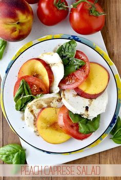 "I can't get over how perfectly ""summer"" this Peach Caprese Salad is! Divine. Courtesy of Iowa Girl Eats!"