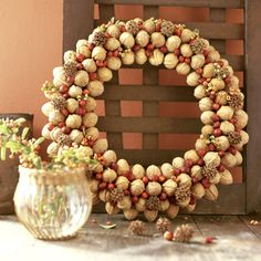 Acorns, small pinecones, berries, I would use more colorful berries and maybe add some glitter spray.  And a ribbon of course.