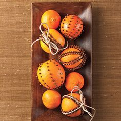 Fruit Pomanders. I have the clove-covered orange I made for my grandmother eons ago (it's at least 25 years old). I keep it in my china cabinet and every time I open the door I think of her. I like the of patterns here rather than covering the whole fruit. And lime and cloves would be a great combination.