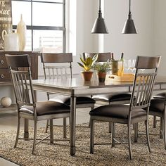 Contemporary + industrial = an absolutely gorgeous dining room set!