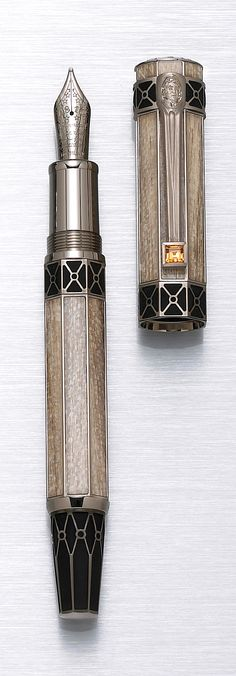 MONTBLANC: Thomas Jefferson Limited Edition America's Signatures for Freedom Series Fountain Pen, This octagonal pen is decorated with solid gold rings bearing engravings from Monticello as well as petrified wood inlays representing Jefferson's commitment to nature and his home. The clip bears a mandarin garnet and is engraved with a portrait of Jefferson.