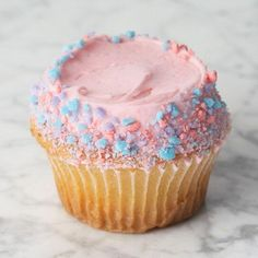 """This is my favorite cupcake in the world, Crumbs' cotton candy.  It's so tasty and much, much prettier in real life.  The first time I had it, I actually got weepy because it tastes like childhood.  Plus it's GIGANTIC (their regular size is 4.25"""" diameter), so you feel like you're a little kid, too."""