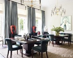 custom-made chairs in the dining area are upholstered in a Lelièvre velvet, the chandeliers are by Nicholas Haslam