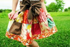 little girl skirt - like this one a lot with the big squares (different fabric tho)...not sure if I like big bow.  Website has more pictures