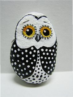 Miniature black and white tiny owl hand painted rock with round yellow eyes. Measures approximately 2 high. Pin and coin not part of listing just used to