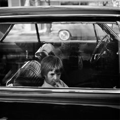 Vivian Maier  -  Untitled. no date, (child in car) / Silver Gelatin Print  -  12 x 12 (on 16x20 paper)
