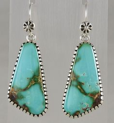 """Dare to wear these statement earrings!  46 carats of Royston turquoise is split from one stone, well matched color and matrix.  Set in sterling silver with a scored bezel by Navajo artist Edison Begay.  1 1/2"""" long sets dangle from his hand made wires, total length is 2"""".  There is some weight, but they don't pull on the ear.  Gorgeous color like the Caribbean Sea.  Buyer pays $7.50 for shipping and insurance."""
