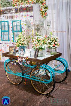 wedding cart , wheelbarrow , floral installation , turquoise and peach decor , white and peach decor , candelabra