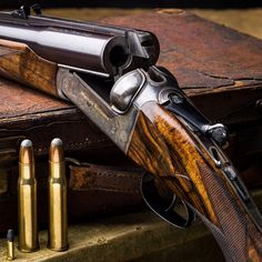 """""""A Westley Richards .577/.500 droplock rifle built in Gold Name finish for a professional hunter. The .22LR round is next to the rifles rounds as comparison. #westleyrichards #bigbore #droplock #doublerifles #PH #safari"""" Photo taken by @_westleyrichards_ on Instagram, pinned via the InstaPin iOS App! http://www.instapinapp.com (06/04/2015)"""