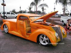 A nod to the classics, this custom truck features a brilliant orange paint job and enough custom work that it maybe doesnt qualify as a true classic, though the original lines and look are beautiful.