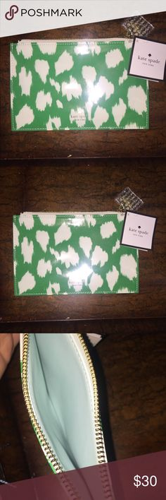 NWT Authentic Kate Spade clutch NWT Authentic Kate Spade clutch. Green & Ivory leopard print. Powder blue lining. Gold hardware. Price not firm. Make an offer! kate spade Bags