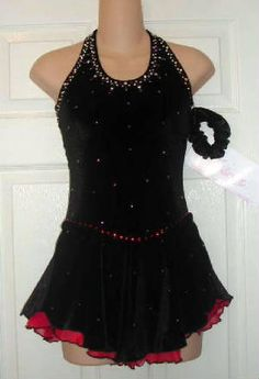 nice front, back too busy and halternecks too constraining...red underskirt and red sparkles at waist...