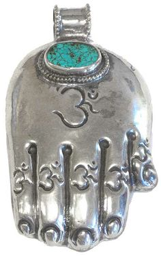 Sterling Hand with Turquoise  Nepal    This lovely sterling silver hand pendent is equally beautiful on both sides. Front has a nice piece of turquoise with a repousse' om figure carved into it and the back has traditional Nepalese repousse' carving with a graceful deer in the center.