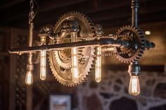 This light fixture is absolutely stunning. Truly embodying the industrial style with its chains, gears, piping, and filament light bulbs, this fixture is the perfect example of how to use creative lighting effectively. Notice in the background the stone and wood adorning the walls of this basement bar and wine cellar - the perfect environment for this piece, and the perfect piece to bring to life the character in this room!