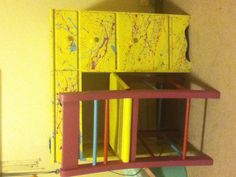 Take an old wooden desk and paint it whatever color you want then splatter paint the rest!