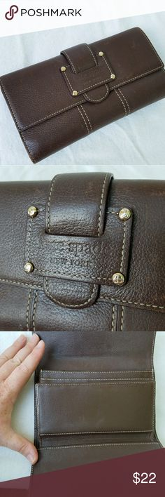 Kate Spade Large tri fold Brown Leather Wallet Tons of storage in this wallet. There is some wear (discoloration) of the leather. Still in excellent condition given that i believe this is about 10 years old. kate spade Bags Wallets
