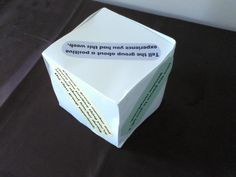 """Positive Psychology Cube. Works great for counseling groups or families. Cube is made of tagboard with colored instructions on each side, such as, """"Give the person to your left a genuine compliment"""" or """"Identify one character strength about the person across the circle."""" Game is played by rolling the cube like a die."""
