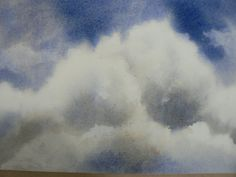Paint a fluffy white cloud with shadows in watercolour - I am using hot pressed 90lb paper and French Ultramarine Blue and Burnt Umber to create this simple ...