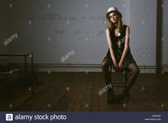 Stock Photo - Fashion model on chair wears hat made with drum set parts -    chair, cloth, copy, couture, cymbals, dress, drum, drumhead, drums, extravagant, fashion, hat, haute, haute-couture, high, horizontal, inside, instruments, looking, model, music, people, photo, posing, pretty, serious, set, shoot, shooting, shot, sitting, space, studio, stylish, trendy, up, urs siedentop, woman