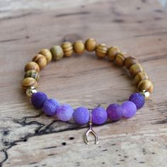 """Agate and Wishbone Bracelet Genuine purple agate and olive wood beads. Wishbone charm and gold beads are real 14k gold filled. Stretchy 7"""" bracelet. Handmade with love. No trades. Custom sizes can be made! Jewelry Bracelets"""
