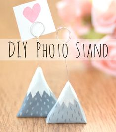 You can make these cute Scandinavian photo stands from air dry clay and wire. Instructions here.