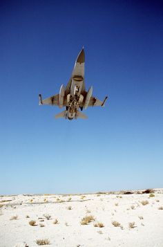 A U.S. Air Force F-16 Fighting Falcon fighter aircraft armed with AIM-9 Sidewinder missiles takes off during Operation Desert Storm. Photo by U.S. Air Force.