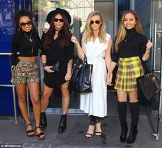 Mixing it up: Little Mix showed off their individual sense of style as they arrived at Cap...