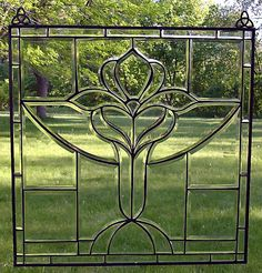 Tulip beveled glass.  Sure would like beveled glass instead of regular glass in all the clerestory windows in my family room!