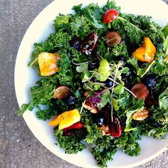 Breakfast salad: Chopped kale, cherries, blueberries, grapes, heirlooms, walnuts from @Stephanie Quilao