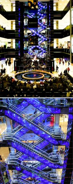"""Beautiful Crisscross Escalator Glowing escalator at the Evropeisky Mall in Moscow, Russia. The crisscross layout minimizes space requirements by """"stacking"""" escalators that go in one direction, frequently used in department stores or shopping centers."""