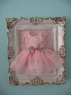 Girl bedroom wall frame. Use her old infant dress to frame when shes a little girl, @Jenna Brown