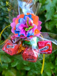These simple and sweet   Fiesta Favors   combine my two favorite colorful south of the border icons -   paper flowers and Chiclets gum......