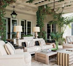 White upholstered outdoor furniture with a stripe accent.