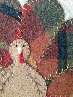 Wool appliqué hand stitched by Mary Ann Thom.