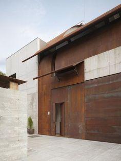 minimalist modern architecture with copper and concrete facade