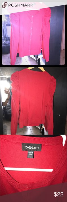 Bebe red sweater small used Bebe red sweater small used bebe Sweaters Cardigans