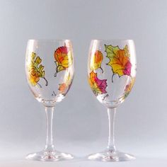 Hand painted fall leaves wine glasses set of two. An array of Fall Leaves in vibrant Fall colors make these painted Fall Leaves Wine glasses Stunning!  Perfect Fall gift Dishwasher safe, Personalized free.