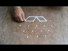 Simple and easy rangoli | दररोज घरासमोर काढण्यासाठी सोपी रांगोळी | easy muggulu - YouTube Rangoli Borders, Beautiful Rangoli Designs, Simple Rangoli, The Creator, Kids Rugs, Youtube, Kid Friendly Rugs, Youtubers, Youtube Movies
