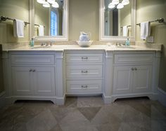 This guest bath has dual vanities with stunning Botticino Fiorito Marble countertops. The floor matches the counters with the same Botticino Fiorito Marble.