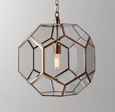 RH baby&child's Giles Faceted Sphere Lantern Pendant Aged Brass:Offering a streamlined take on the traditional oil lantern, our fixture features a geometric metal frame with clear glass panels and an ingenious hidden access point that allows for bulb changes.