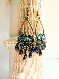 Hand Made Peacock Earring with Fresh Watter Peacock Pearls.. Starting at $3 on Tophatter.com!