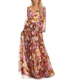 Light and flowy, this maxi dress boasts airy sleeves and a sweet surplice neckline.