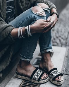Textured patterned slip ons + rolled jeans + loose knit cardigan wrap + wrap bracelets