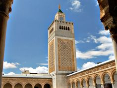 Grand Mosque Bell Tower under blue skies in Tunisia