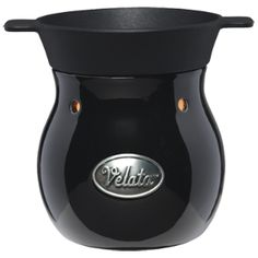 Noir Velata Fondue Warmer  This sophisticated warmer is glazed in deep, glossy black.  Warmer price includes 4 forks.