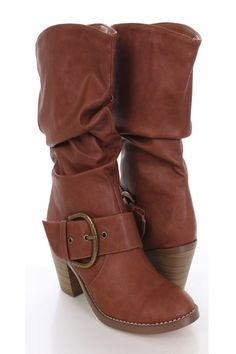 Make a fashion statement with these sexy boots! They will look super hot paired with your favorite skinnies or dress. Make sure you add these to your closet, it definitely is a must have! The features include a faux leather upper with a slouchy design, stitched detailing, strap with large side buckle accent, slip on design, smooth lining, and cushioned footbed. Approximately 2 1/2 inch heels and 1/2 inch platforms, 13 inch circumference, and 9 inch shaft.