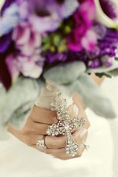 Incorporate a family rosary or cross for a bridal bouquet!!