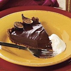 Rich Chocolate Tart... A gingersnap crust holds the rich, creamy chocolate filling of this tart. Garnish it with sweetened whipped cream. MyRecipes.com